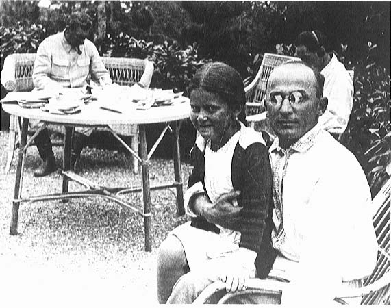 Beria with Stalin (in background) and Stalin's daughter Svetlana